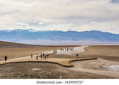 DEATH VALLEY, CALIFORNIA, USA - April 4, 2019: People visit the Saltsee and Badwater basin at 282 feet below sea level, Badwater Basin is the lowest point in the USA.