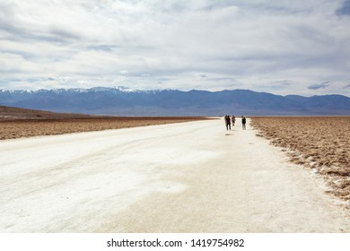 DEATH VALLEY, CALIFORNIA, USA - April 4, 2019: People visit the area of Badwater Basin. Badwater Basin is the lowest point in the USA.