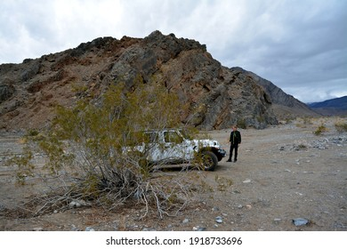 Death Valley, California, USA - December 23, 2019 - white Jeep Wrangler Sahara off road in the Cottonwood Canyon
