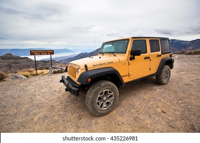 DEATH VALLEY NATIONAL PARK, CALIFORNIA - MARCH 5, 2016: Yellow Jeep Wrangler Rubicon Parked at Auguereberry Point on March 5, 2016 in Death Valley National Park.