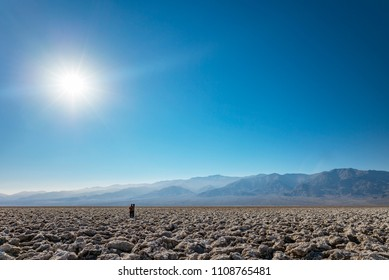 Death Valley Person Standing in the Sun, Badwater Basin Salt Flats, California, USA