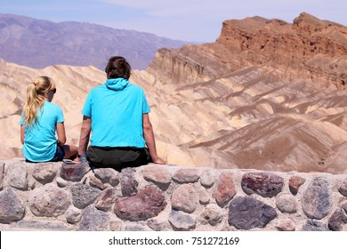 Death Valley tourists people in California enjoying view desert landscape of Zabriskie Point in Death Valley National Park, California, USA. Travel road trip in United States.