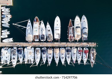 Deatil of pier with boats and yachts in Portisco marina, Sardinia, Italy