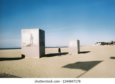 Deauville, France - Nov, 2018 : unknown man standing on the beach in Deauville taken by lomography 800 film