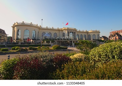 DEAUVILLE, FRANCE-MAY 05,2018: Casino Barriere de Deauville (Fr: Deauville Le Normandy the casinos) beautiful building at the seaside. Early morning view.