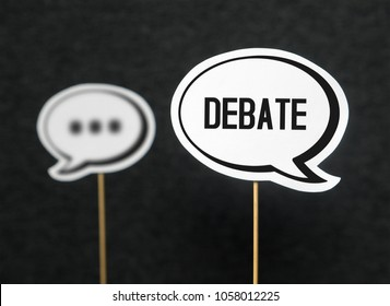 Debate, dialog, communication and education concept. Talking about political opinions. Two cardboard speech bubbles.