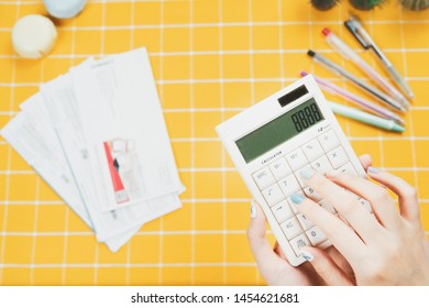 debit and accounting activity from beauty woman hand calculating by calculator for summary monthly sale and debt cost with bill , sale slip and yellow background