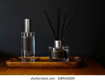 De-branded room spray and reed diffuser with black detail label on a walnut wooden tray.