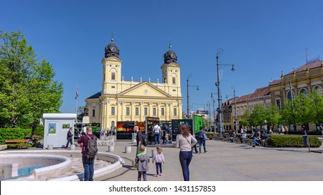 DEBRECEN, HUNGARY -04 19 2019 People looking at Mate Bence Nature Photography Exhibition at Kossuth Square in Debrecen