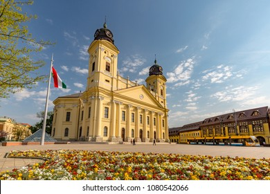 DEBRECEN, Hungary - April 23 2018: Kossuth square with Protestant Great Church (Hungarian: Reformatus Nagytemplom) on the background in Debrecen city. Beautiful traditional European city center