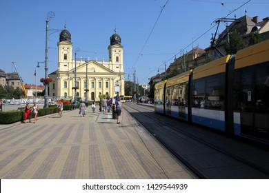 DEBRECEN, HUNGARY - August 13, 2018: Kossuth square with Protestant Great Church (Hungarian: Reformatus Nagytemplom) street view