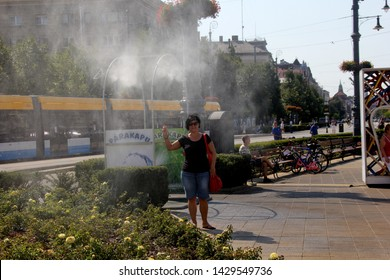 DEBRECEN, HUNGARY - August 13, 2018: City street view, people off the street fountains in hot summer time