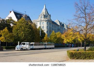 DEBRECEN, HUNGARY - OCTOBER 31, 2015: White train on Market Street (Hungarian: Piac utca), the major street in Debrecen city, Hungary