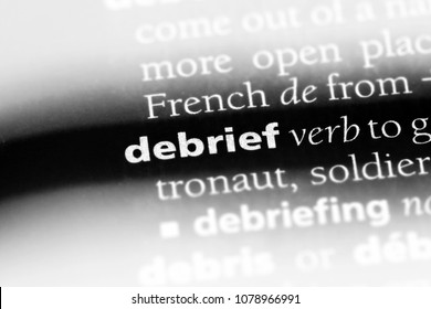 debrief word in a dictionary. debrief concept