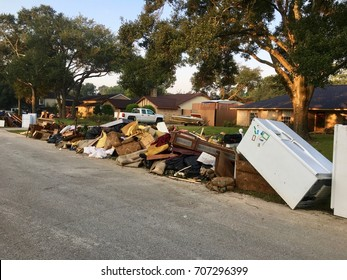 Debris from Hurricane Harvey flooding damage. Neighborhood clean up in North Hill Estates, Spring TX, a couple miles north of Houston.