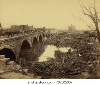 Debris at Pennsylvania Railroad stone bridge, after the Johnstown Flood of May 31, 1889. This was the most horrific site of the disaster. The bridge blocked the onslaught of tons of debris, carried by
