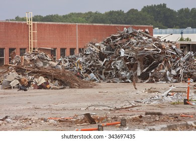 Debris Piles Of Twisted Metal Stacked At Demolition Site