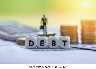 Debt credit card and money coin stack / Increased liabilities from exemption debt consolidation concept of financial crisis and problems risk business management loan interest