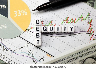 Debt and equity letter cube on white candle stick chart background. conceptual image for D/E ratio in stock investment.