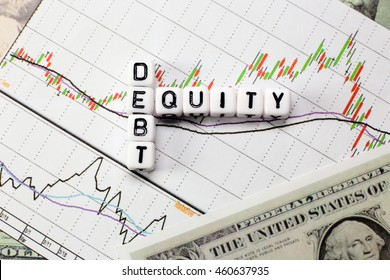 Debt and equity letter cube on white candle stick chart and dollar background. conceptual image for D/E ratio in stock investment.