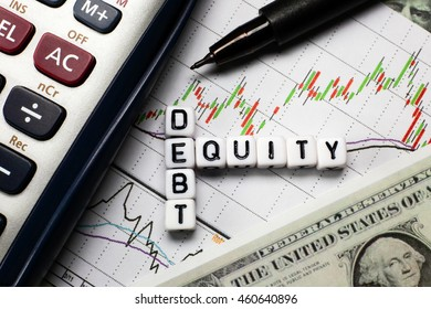 Debt and equity letter cube on white candle stick chart and dollar background. conceptual image for D/E ratio of the investment.