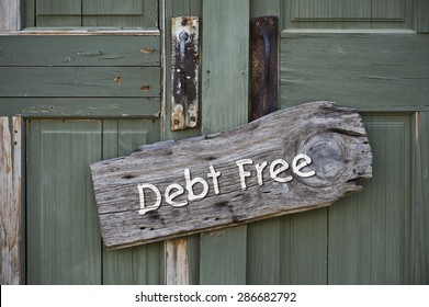 I am debt free sign on green doors.