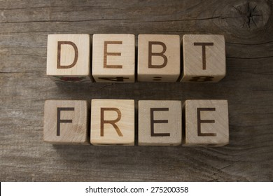debt free text on a wooden background