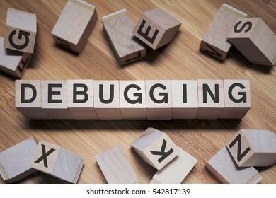 Debugging Word Written In Wooden Cube