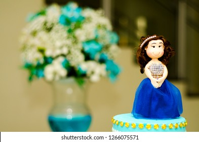 Debutant doll on the cake.
