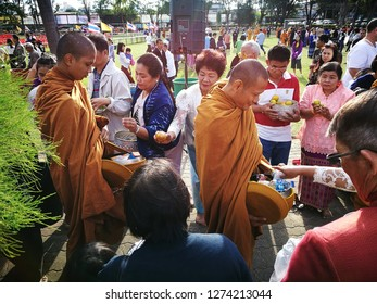 Dec 01 2019: Ubonratchatani, Thailand: Buddhist give food for monk at Happy New year eve day. Faith and believable in Buddha.