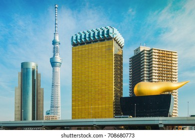 Dec 04, 2016: Tokyo skyscraper across the river in Asakusa including the Tokyo Skytree and the Asahi Beer Hall in Tokyo, Japan