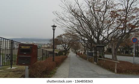 Dec 05 2018: Hakodate, Japan: Cityscape at Hakodate, Hachimansaka Dori and Hill. near Red Brick Warehouse, Christmas street at Hakodate, Hokkaido, Japan