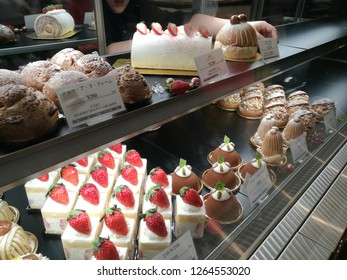Dec 08 2018: Tokyo japan: Delicious fruit cake and bakery cream on shelf in bakery and coffee shop. Freshness handmade bakery and cake.