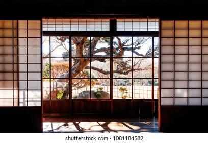 DEC 11, 2012 Chiba, JAPAN - Old vintage Tatami and sliding wall living room in former Hotta Samurai house with garden view in Sakura city, famous Edo Samurai village near Tokyo.