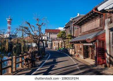 DEC 11, 2012 Katori, Chiba, JAPAN - Old vintage wooden Japanese house along small street by Tonegawa river in Sawara village, famous little Edo old town near Tokyo.