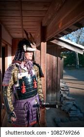 DEC 12, 2012 Chiba, JAPAN - Asian Man in Samurai armor suit and warlord hat holding Japanese Katana sword