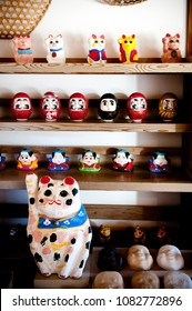 DEC 12, 2012 Chiba, JAPAN - Vintage Japanese style souvenir,  Paper mache Daruma and Maneki Neko dolls in Souvenir shop at Boso No Mura Open air museum, Edo town ancient village