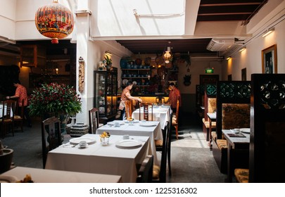 DEC 18, 2013 Singapore - Traditional Peranakan restarant in old Baba Nyonya style house, with open space for light at center. Fully furnished with Chinese style furniture
