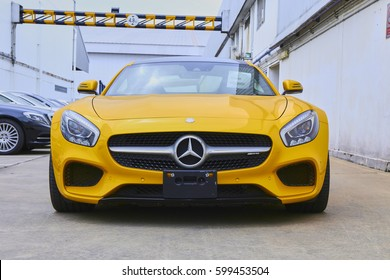 Dec 2016, Samut Prakan, Thailand : Yellow Mercedes-AMG GTS in warehouse, In front of view.