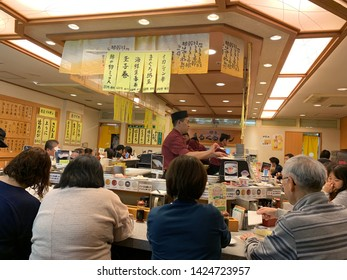 Dec 2018 - Hokkaido, Japan: Conveyor belt sushi, is a form of sushi restaurant common in Japan. Hand made sushi are placed on belt and it will go round the table in front of customers.