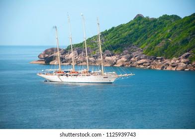 DEC 21, 2009 Phang Nga - Phuket, Thailand - High angle view of Similan island and luxury cruise ship Andaman sea.