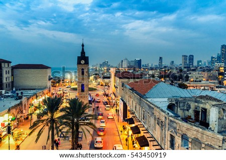 DEC 23, 2016 -  Top view on Jaffa, Israel. Clock tower and the main street at sunset. Tel Aviv skyline.