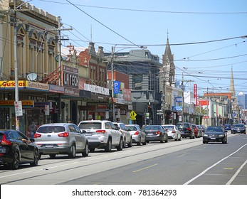 Dec 25th 2017, cars waiting for traffic light at suburban street with tram track. Urban busy street in Melbourne's inner suburb with church and many local shops. Brunswick, VIC Australia.