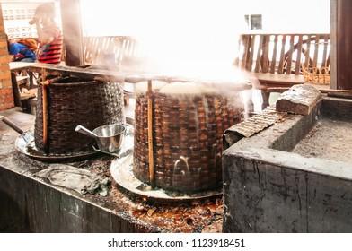 DEC 27, 2009 Bangkok, Thailand - Boiling pan on stove traditional original process of make Palm sugar  in Thailand