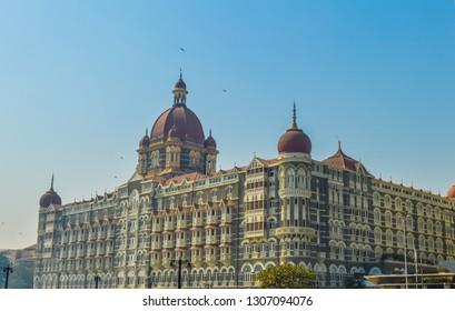 Dec 29 2018:Beautiful Taj Palace hotel on the Mumbai harbour with many jetties on Arabian sea near Chhatrapati Shivaji monument