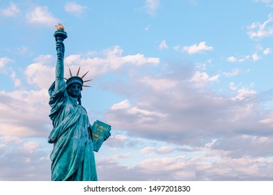 DEC 5, 2019 Tokyo, Japan - Statue of Liberty at Odaiba Tokyo - Japan aginst beautiful blue evening sky. Replica of original monument in New York. With copy space on one side