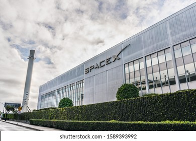 Dec 8, 2019 Hawthorne / Los Angeles / CA / USA - SpaceX (Space Exploration Technologies Corp.) headquarters; Falcon 9 rocket displayed on the left; SpaceX is a private American aerospace manufacturer