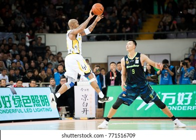 Dec 9, 2017 - Beijing, China: Fomer NBA player Stephon Marbury defended by Yi Jianlian during a CBA game between Beijing Fly Dragons and Guangdong, on December 9, 2017, in Beijing, China.