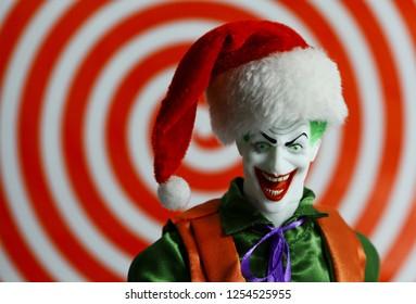 DEC 9 2018: DC Comic bad guy The Joker wearing a Christmas Santa hat - Mego Action Figure