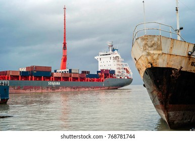 Dec2017, Honiara< Solomon Islands, ports and jetties at the harbour where an international container ship is parked between smaller inter island vessels